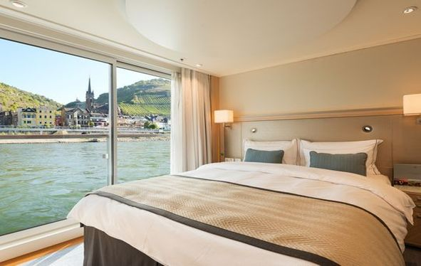 Bedroom window of Viking Longship sailing past landscape