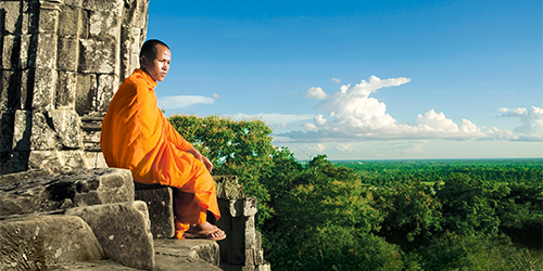Monk on top of Angkor Wat temple