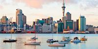Boats on the water in front of the cityscape of Auckland, New Zealand
