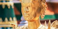 Gold, jeweled statue at the Grand Palace in Bangkok, Thailand