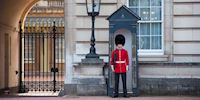 Guard in a guardhouse at Buckingham Palace in London, England