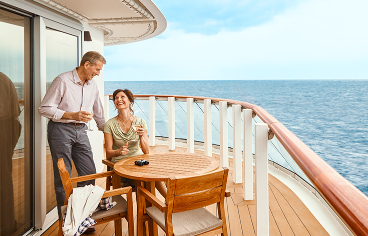A couple enjoying the breeze on the veranda of their Explorers Suite.