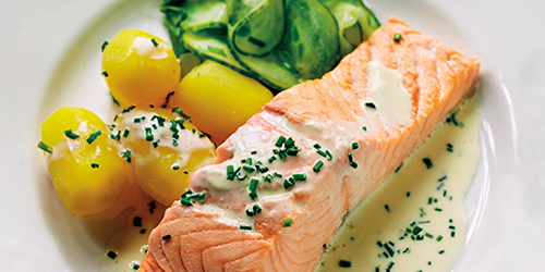 Poached salmon on serving plate