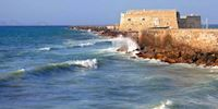 Waves hit a seaside fortres in Heraklion