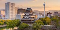 Skyline in Hiroshima with an ancient castle mixed with modern buildings.