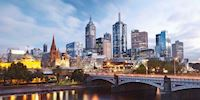 Melbourne skyline with a mix of old and new buildings across a bridge