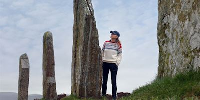 Karine Hagen with standing stones in Orkney Islands, Scotland