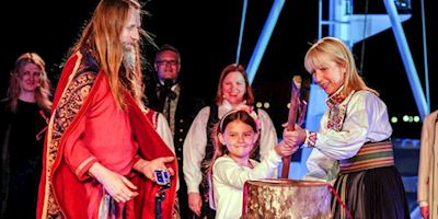 Using ceremonial axe at Viking Sea christening